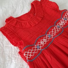 Is it too early for Christmas..... an adorable little red hand smocked dress is now in store. Love !!!