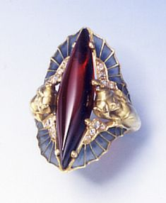 A rare Art Nouveau garnet, diamond, plique-à-jour enamel and gold ring, by René Lalique, circa 1900s.