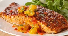 "Sweet and Smoky Salmon with Orange Salsa. Cool and fruity Orange Salsa complements the sweet n smoky seasoned salmon fillets. ""This is some of the best salmon you will ever have! Janice H Salmon Recipes, Fish Recipes, Seafood Recipes, Great Recipes, Cooking Recipes, Favorite Recipes, Healthy Recipes, Fish Dishes, Seafood Dishes"