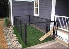 A small (very small) backyard dog run right off the porch or deck. Great for a house without a fenced in yard