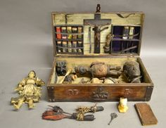 * 19th Century Voodoo kit in wooden box. Possibly belonging to Voodoo Priestess Marie Laveau or one of her disciples. Includes wax doll, skull, claw, shell, mystical herbs and more