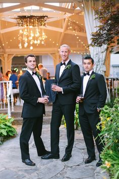 Chris and his groomsmen enjoy a cocktail in the garden while this custom chandelier from @nasheventlight steals the show at the reception. Edison bulbs, hanging crystals and string lights wrapped through branches were super cool both day and night.  CJ's Off the Square | Nashville Garden Wedding Venue #groomsmen