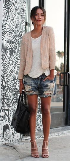 White loose blouse with denim short skirt and pink loose sweater and black leather hand bag and matching pink high heels ladies sandals the ...