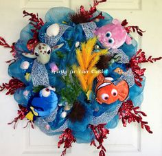 Finding Nemo Wreath. This fun wreath was a custom order for a little boys birthday party! The wreath is made with turquoise deco mesh and a