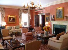 Living room with burnt orange Venetian stucco walls -- Ellie Cullman and Tracey Winn Pruzan -- New York Social Diary