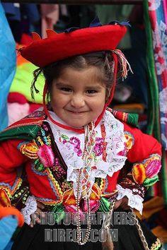 Paucartambo, near Cusco, Peru.  Girl in traditional dress at Virgen del Carmen festival