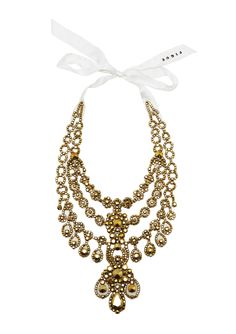 Uniquely crafted jewel-embellished statement necklace in gold with tie closure. Inspired by the precious jewels of the Maharaja. So glamorous!