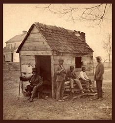 """The children of slaves at """"Uncle Gabriel's Cabin,"""" 1860 -1900. Once """"freed"""", many of the former slaves and their children had no where to go and continued living on the property of their former slave masters.— at South Carolina."""