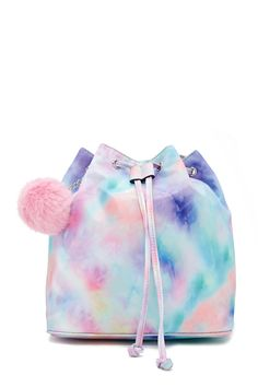 A structured satin backpack featuring a rainbow tie-dye design, a detachable pom pom chain, a drawstring and magnetic snap closure, two interior slip pockets, and adjustable buckle straps.