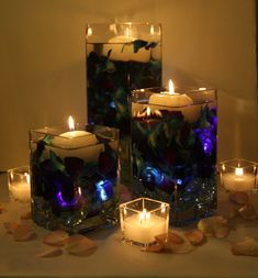 Blue dendrobium orchid centerpieces with floating candles nighttime