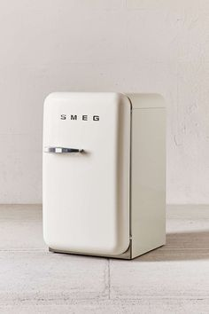 Smeg Mini Refrigerator - it's reasonable to spend $1k on a mini-fridge, right? This elevates the look? ;)
