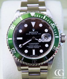 A collectible Rolex Anniversary Submariner in mint condition with green bezel. Certified pre-owned Rolex with box and a 2 year warranty. Rolex Submariner 16610, Used Rolex, Rolex Oyster Perpetual Date, Thing 1, Pre Owned Rolex, Certified Pre Owned, Watches Online, Rolex Watches