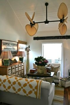 Beach House Eclectic-Folk art in the Family Room. Via Kelley and Company