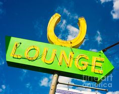 Lucky U Lounge in Austin! Love this green and yellow neon sign. Photo by Sonja Quintero