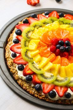 """This HEALTHY version of fruit pizza is made with our very popular Pinterest recipe: """"Best Fruit Dip Ever"""". The base is a very easy, 3 ingredient, healthy, gluten-free and clean eating approved oatmeal banana cookie! This is a winning combination of healthiness and the best summertime flavors. We have been making fruit pizza for years. …"""
