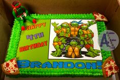 Ninja Turtles Vanilla cake Filled with vanilla frosting / melted chocolate Iced with vanilla frosting Print on icing sheet Decorations made out of modeling chocolate