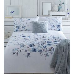 Perfect for adding a sophisticated splash of colour, this duvet cover is designed by John Rocha and features a painterly floral print in deep…