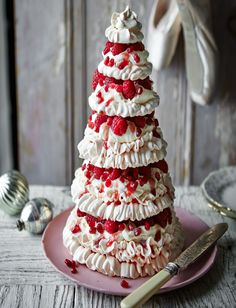Our jewelled pavlova tower recipe makes a striking showstopper. Packed with cream and raspberries, this elegant meringue bake will make a superb Christmas Day dessert