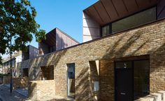 Bell Phillips Architects' model homes for the elderly, Greenwich British Architecture, Residential Architecture, Modern Architecture, Roof Design, Exterior Design, House Design, Greenwich House, Brick Arch, Brick Facade