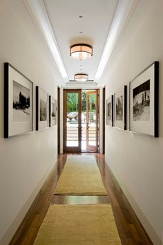 Decoration,Narrow Hallway Lighting Ideas With Drum Shade Ceiling Light And Wall Mounted Painting Featuring Beige Rug Area And Laminated Wooden Flooring Combine With Swing Glass Door,Classy Narrow Hallway Lighting Ideas Hallway Art, Hallway Lighting, Long Hallway, Modern Hallway, Upstairs Hallway, Hallway Pictures, Hang Pictures, Narrow Hallway Decorating, Narrow Entryway