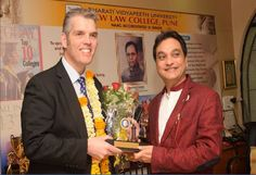 Prof.Dr.Mukund Sarda Andrew Chadwick Deputy Dean School of Law BPP university ‪‎Uk‬ being felicitated by Prof. Dr Mukund Sarda, Dean Faculty of Law and Principal of New Law College ‪ Pune‬ .