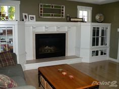 Fireplace with cabinets that extend out
