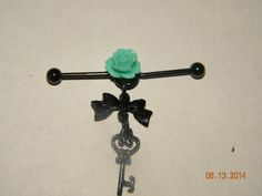 Bow and key industrial bar with rose by Heat5Her on Etsy, $5.00