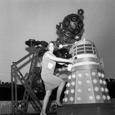 Verity Lambert, producer of the BBC TV series Dr Who, with a robot Dalek in the Planetarium, Baker Street, during location shooting for a new series. Ref #: PA.5786545 Date: 20/08/1964