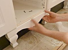 DIY Furniture Style Cabinet- How to make your bathroom vanity look like those pricey furniture style vanities- PlumDoodles.com