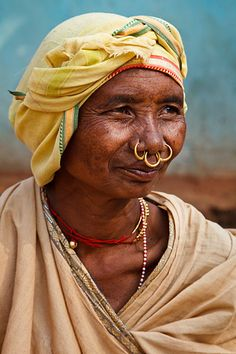 Portrait of a low land Mali tribal woman with traditional piercings
