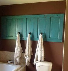Turquoise (or whatever great color) and dimensional for the wall. I love the turquoise, chocolate, and white together. Dishfunctional Designs: New Looks For Old Salvaged Doors: More Repurposed Door Ideas!