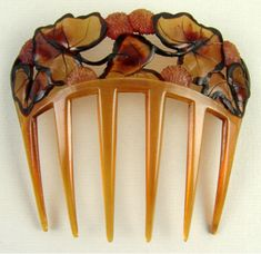 Art Nouveau Autumn Leaves Hair Comb. Carved and Tinted Tortoiseshell. France. Circa 1905.