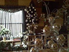 ribbon strung bulbs hanging from tree. elegant !