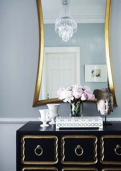 chic and feminine dressing table in black and gold
