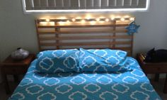 Old set of bed slats repurposed into a headboard