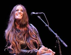 You oughta know she loves it. Alanis Morissette is all smiles during a performance at congressional candidate Marianne Williamson's campaign rally on May 19 in Beverly Hills, Calif.