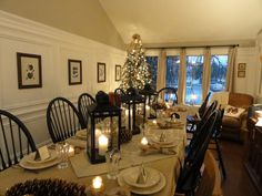 Love those black Windsor chairs - the black laterns are perfect with them!