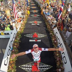GoPro Featured Photographer - @donaldmiralle About the Shot: @JanFrodeno of Germany crosses the finish line with a time of 8:14:40 becoming the new Ironman World Champion during the 2015 Ironman World Championships in Kailua-Kona Hawaii on October 10 2015. Considered one of the most grueling races in the world competitors must swim a 2.4 mile (3.86km) in open ocean a 112 mile bike (180.25km) and a marathon 26.2 mile (42.2km) run in 90 degree heat and humidity under a 17-hour cutoff to be…