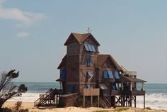 """""""The Inn at Rodanthe"""" Beach House, a.k.a. """"Serendipity"""", Outer Banks, North Carolina - The house was used in filming all exterior """"Inn"""" scenes for the movie """"Nights in Rodanthe"""" After sustaining damage during Hurricane Bill in August 2009 a new owner had it lifted off its foundation, placed on a trailer and trucked seven-tenths of a mile down N.C. Highway 12, then back toward the ocean to a new waterfront perch less vulnerable to storms."""