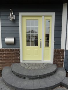 Clear glass with white grills by Portatec, Benjamin Moore Lemon Merangue coloured single entry door with one sidelite.
