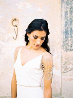Gorgeous chain sleeve wedding dress detail: http://www.stylemepretty.com/little-black-book-blog/2016/02/04/modern-boho-meets-british-bridal-inspiration/ | Photography: Ashlee Taylor - http://www.ashleetaylor.com/