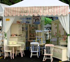 An outdoor festival - the curtains and banner make the booth look inviting.