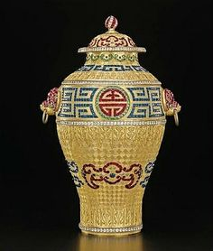 A magnificent and rare imperial paste-inset gilt-bronze vase and cover, Qianlong Period (1736-1795).