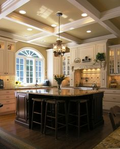 Kitchen... Love the light cabinets exterior and dark cabinet island. Also love the ceiling!