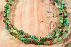 Beautiful 3 Strand Necklace featuring Genuine Jade. Spiny Oyster Shell and Turquoise Accents. Created by Santo Domingo Artist Carol Pacheco. http://www.treasuresofthesouthwest.com/turquoise-jewelry.html