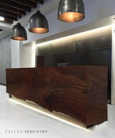 Waterfall reception desk in residential Tribeca lobby. Made from a signle claro walnut cut. LEDs highlight the live edge.