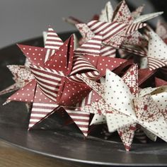 Scandinavian folded star ornaments that I made with my Grandmother! We dipped them in wax so they were not quite so crushable. Fond memories!