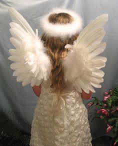 ok this would be more like it Medium upright white feather angel wings and matching halo