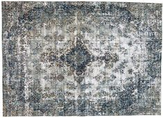 Vintage hand-knotted Persian rug with a floral medallion design.