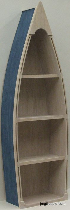 Love this shelf!! Wish it didn't cost $179!! This would have been perfect for Aidan's room =0( 5 Foot blue row Boat Bookshelf Bookcase shelves skiff schooner canoe shelf nautical man cave Dorey kids room